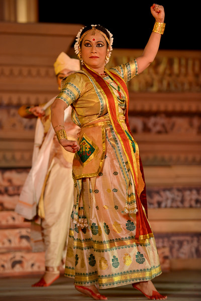 "Anita Sharma & Troupe, Satriya Group's dance performance at the Khajuraho Festival of Dances February, 2014.  Khajuraho Festival of Dances is celebrated at a time when the hardness of winter begins to fade and the king of all seasons, spring, takes over. The most colorful and brilliant classical dance forms of India with their roots in the ling and rich cultural traditions across the country, offer a feast for the eyes during a weeklong extravaganza.  Khajuraho is located in the Indian state of Madhya Pradesh and roughly 620 kilometers (385 miles) southeast of New Delhi, the temples of Khajuraho are famous for their so-called ""erotic sculptures"". Khajuraho was the cultural capital of the Chandela Rajputs, a Hindu dynasty that ruled from the 10th to 12th centuries."