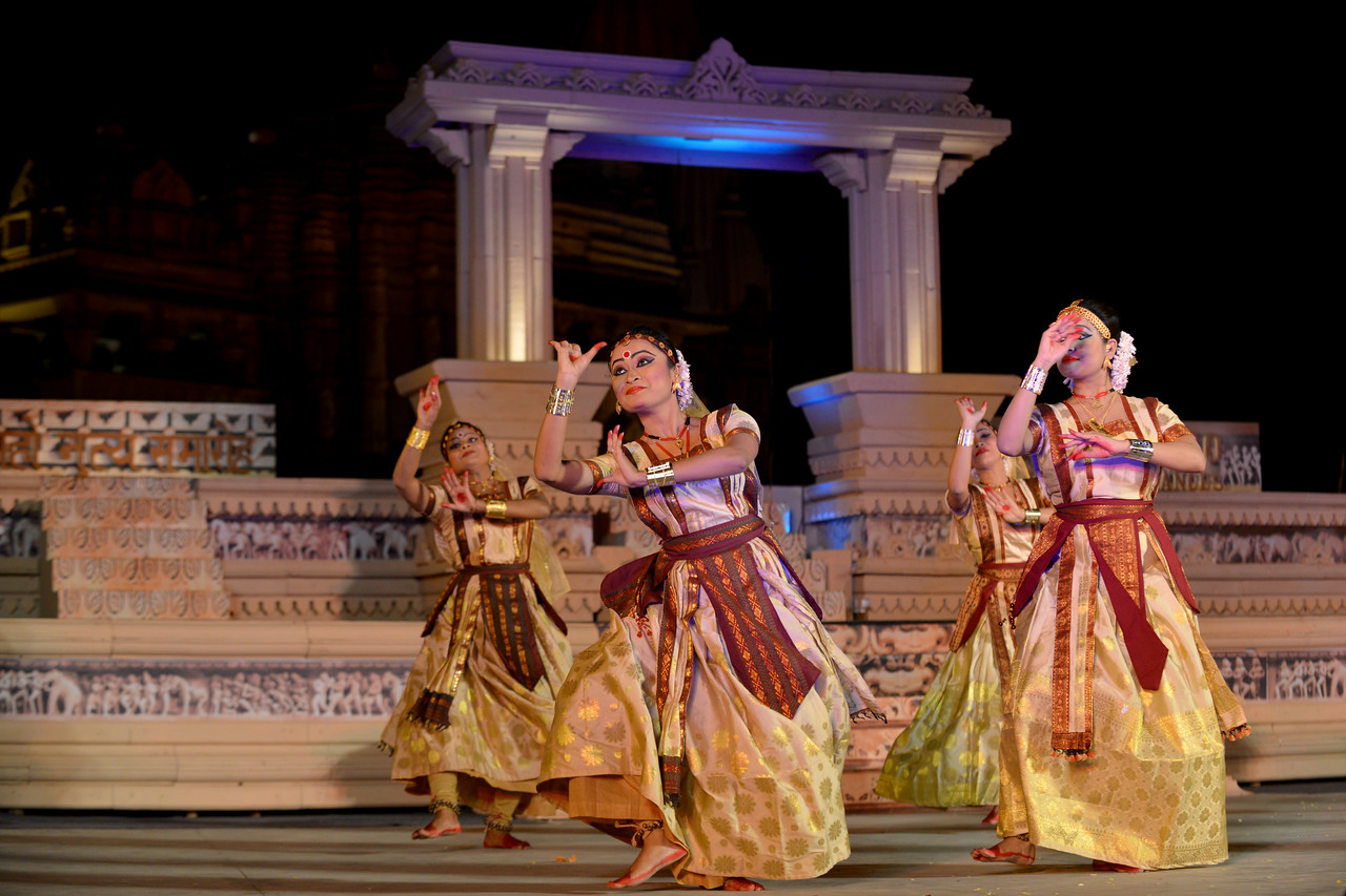 """Anita Sharma & Troupe, Satriya Group's dance performance at the Khajuraho Festival of Dances February, 2014.<br /> <br /> Khajuraho Festival of Dances is celebrated at a time when the hardness of winter begins to fade and the king of all seasons, spring, takes over. The most colorful and brilliant classical dance forms of India with their roots in the ling and rich cultural traditions across the country, offer a feast for the eyes during a weeklong extravaganza.<br /> <br /> Khajuraho is located in the Indian state of Madhya Pradesh and roughly 620 kilometers (385 miles) southeast of New Delhi, the temples of Khajuraho are famous for their so-called """"erotic sculptures"""". Khajuraho was the cultural capital of the Chandela Rajputs, a Hindu dynasty that ruled from the 10th to 12th centuries."""
