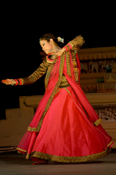 """Kathak & Uzbek dance performance by Samiksha Sharma, Dhirendra Tiwari, and Diyor Aliev at the Khajuraho Festival of Dances February, 2014.  Khajuraho Festival of Dances is celebrated at a time when the hardness of winter begins to fade and the king of all seasons, spring, takes over. The most colorful and brilliant classical dance forms of India with their roots in the ling and rich cultural traditions across the country, offer a feast for the eyes during a weeklong extravaganza.  Khajuraho is located in the Indian state of Madhya Pradesh and roughly 620 kilometers (385 miles) southeast of New Delhi, the temples of Khajuraho are famous for their so-called """"erotic sculptures"""". Khajuraho was the cultural capital of the Chandela Rajputs, a Hindu dynasty that ruled from the 10th to 12th centuries."""