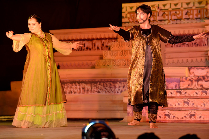 """Zebiniso Davlatova and Kohinoor Kathak.  Kathak & Uzbek dance performance by Samiksha Sharma, Dhirendra Tiwari, and Diyor Aliev at the Khajuraho Festival of Dances February, 2014.  Khajuraho Festival of Dances is celebrated at a time when the hardness of winter begins to fade and the king of all seasons, spring, takes over. The most colorful and brilliant classical dance forms of India with their roots in the ling and rich cultural traditions across the country, offer a feast for the eyes during a weeklong extravaganza.  Khajuraho is located in the Indian state of Madhya Pradesh and roughly 620 kilometers (385 miles) southeast of New Delhi, the temples of Khajuraho are famous for their so-called """"erotic sculptures"""". Khajuraho was the cultural capital of the Chandela Rajputs, a Hindu dynasty that ruled from the 10th to 12th centuries."""
