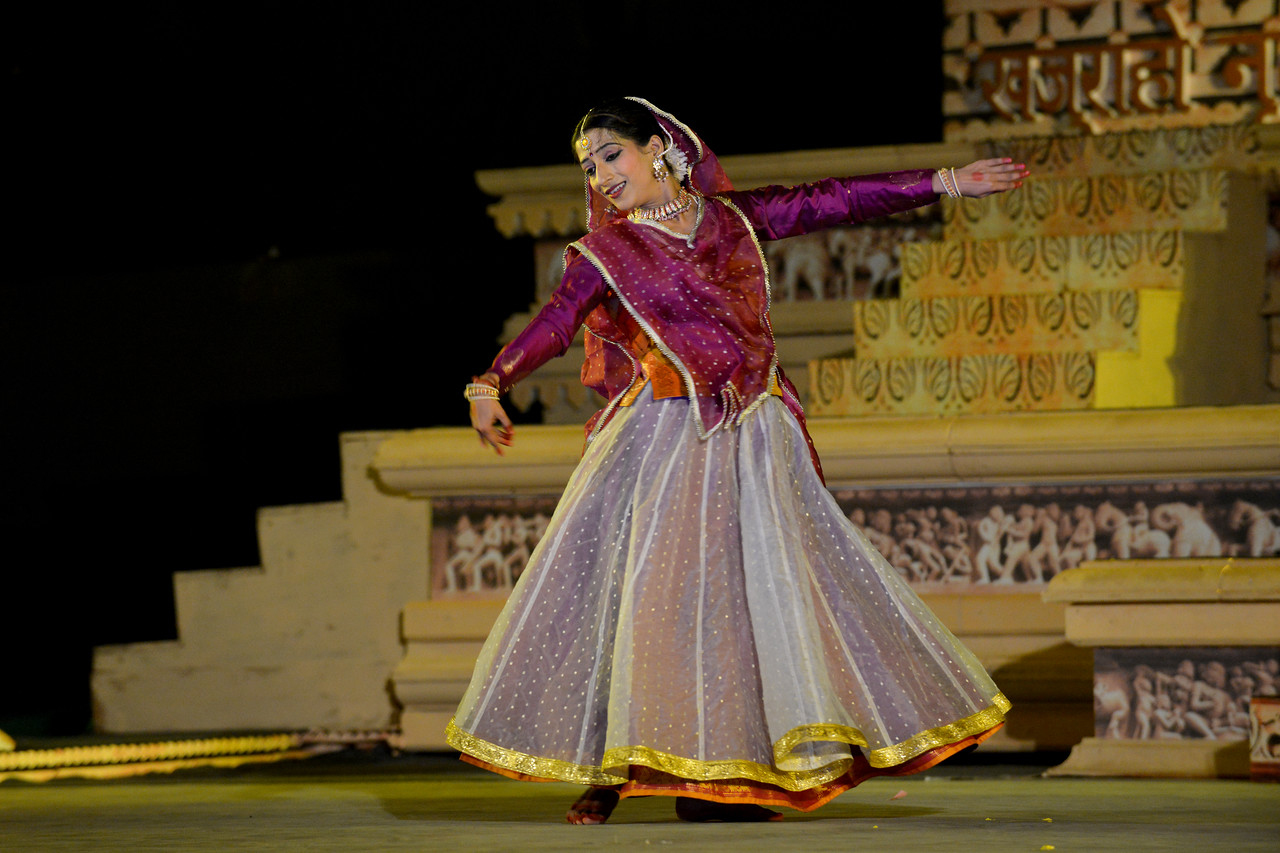 """Vidyagauri Adkar's Kathak performance at the Khajuraho Festival of Dances.<br /> <br /> This festival is celebrated at a time when the hardness of winter begins to fade and the king of all seasons, spring, takes over. The most colorful and brilliant classical dance forms of india with their roots in the ling and rich cultural traditions across the country, offer a feast for the eyes during a weeklong extravaganza.<br /> <br /> Khajuraho is located in the Indian state of Madhya Pradesh and roughly 620 kilometers (385 miles) southeast of New Delhi, the temples of Khajuraho are famous for their so-called """"erotic sculptures"""". Khajuraho was the cultural capital of the Chandela Rajputs, a Hindu dynasty that ruled from the 10th to 12th centuries."""