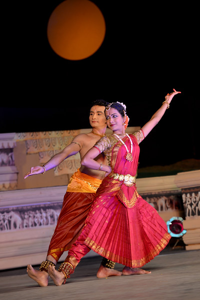 "Jignesh Surani and Swarada Datar. Vaibhav Arekar & Troupe, Bharatnatyam Group's dance performance at the Khajuraho Festival of Dances February, 2014.  Khajuraho Festival of Dances is celebrated at a time when the hardness of winter begins to fade and the king of all seasons, spring, takes over. The most colorful and brilliant classical dance forms of India with their roots in the ling and rich cultural traditions across the country, offer a feast for the eyes during a weeklong extravaganza.  Khajuraho is located in the Indian state of Madhya Pradesh and roughly 620 kilometers (385 miles) southeast of New Delhi, the temples of Khajuraho are famous for their so-called ""erotic sculptures"". Khajuraho was the cultural capital of the Chandela Rajputs, a Hindu dynasty that ruled from the 10th to 12th centuries."