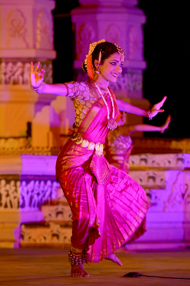 "Swarada Datar. Vaibhav Arekar & Troupe, Bharatnatyam Group's dance performance at the Khajuraho Festival of Dances February, 2014.<br /> <br /> Khajuraho Festival of Dances is celebrated at a time when the hardness of winter begins to fade and the king of all seasons, spring, takes over. The most colorful and brilliant classical dance forms of India with their roots in the ling and rich cultural traditions across the country, offer a feast for the eyes during a weeklong extravaganza.<br /> <br /> Khajuraho is located in the Indian state of Madhya Pradesh and roughly 620 kilometers (385 miles) southeast of New Delhi, the temples of Khajuraho are famous for their so-called ""erotic sculptures"". Khajuraho was the cultural capital of the Chandela Rajputs, a Hindu dynasty that ruled from the 10th to 12th centuries."
