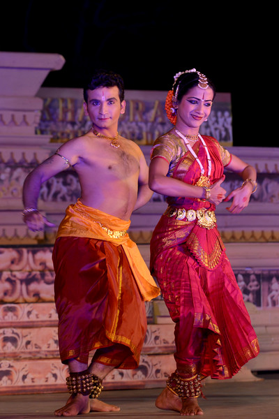 """Jignesh Surani and Swarada Datar. Vaibhav Arekar & Troupe, Bharatnatyam Group's dance performance at the Khajuraho Festival of Dances February, 2014.  Khajuraho Festival of Dances is celebrated at a time when the hardness of winter begins to fade and the king of all seasons, spring, takes over. The most colorful and brilliant classical dance forms of India with their roots in the ling and rich cultural traditions across the country, offer a feast for the eyes during a weeklong extravaganza.  Khajuraho is located in the Indian state of Madhya Pradesh and roughly 620 kilometers (385 miles) southeast of New Delhi, the temples of Khajuraho are famous for their so-called """"erotic sculptures"""". Khajuraho was the cultural capital of the Chandela Rajputs, a Hindu dynasty that ruled from the 10th to 12th centuries."""
