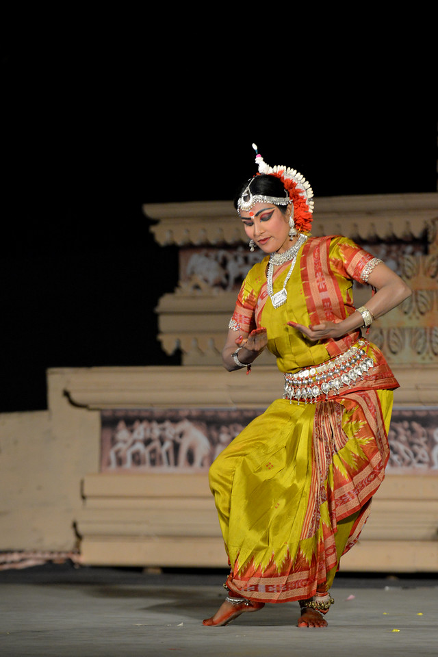 """Bithika Mistry's Odissi dance performance at the Khajuraho Festival of Dances February, 2014.<br /> <br /> Khajuraho Festival of Dances is celebrated at a time when the hardness of winter begins to fade and the king of all seasons, spring, takes over. The most colorful and brilliant classical dance forms of India with their roots in the ling and rich cultural traditions across the country, offer a feast for the eyes during a weeklong extravaganza.<br /> <br /> Khajuraho is located in the Indian state of Madhya Pradesh and roughly 620 kilometers (385 miles) southeast of New Delhi, the temples of Khajuraho are famous for their so-called """"erotic sculptures"""". Khajuraho was the cultural capital of the Chandela Rajputs, a Hindu dynasty that ruled from the 10th to 12th centuries."""