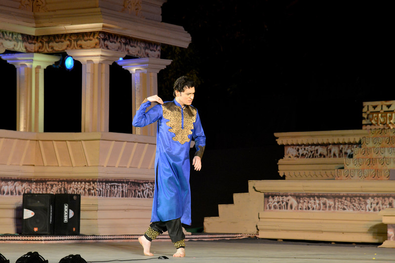 "Dheerendra Tiwari.<br /> Kathak & Uzbek dance performance by Samiksha Sharma, Dhirendra Tiwari, and Diyor Aliev at the Khajuraho Festival of Dances February, 2014.<br /> <br /> Khajuraho Festival of Dances is celebrated at a time when the hardness of winter begins to fade and the king of all seasons, spring, takes over. The most colorful and brilliant classical dance forms of India with their roots in the ling and rich cultural traditions across the country, offer a feast for the eyes during a weeklong extravaganza.<br /> <br /> Khajuraho is located in the Indian state of Madhya Pradesh and roughly 620 kilometers (385 miles) southeast of New Delhi, the temples of Khajuraho are famous for their so-called ""erotic sculptures"". Khajuraho was the cultural capital of the Chandela Rajputs, a Hindu dynasty that ruled from the 10th to 12th centuries."