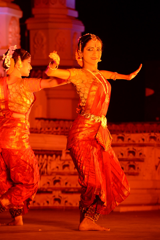 "Vaibhav Arekar & Troupe, Bharatnatyam Group's dance performance at the Khajuraho Festival of Dances February, 2014.<br /> <br /> Khajuraho Festival of Dances is celebrated at a time when the hardness of winter begins to fade and the king of all seasons, spring, takes over. The most colorful and brilliant classical dance forms of India with their roots in the ling and rich cultural traditions across the country, offer a feast for the eyes during a weeklong extravaganza.<br /> <br /> Khajuraho is located in the Indian state of Madhya Pradesh and roughly 620 kilometers (385 miles) southeast of New Delhi, the temples of Khajuraho are famous for their so-called ""erotic sculptures"". Khajuraho was the cultural capital of the Chandela Rajputs, a Hindu dynasty that ruled from the 10th to 12th centuries."