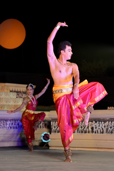 "Vaibhav Arekar. Vaibhav Arekar & Troupe, Bharatnatyam Group's dance performance at the Khajuraho Festival of Dances February, 2014.  Khajuraho Festival of Dances is celebrated at a time when the hardness of winter begins to fade and the king of all seasons, spring, takes over. The most colorful and brilliant classical dance forms of India with their roots in the ling and rich cultural traditions across the country, offer a feast for the eyes during a weeklong extravaganza.  Khajuraho is located in the Indian state of Madhya Pradesh and roughly 620 kilometers (385 miles) southeast of New Delhi, the temples of Khajuraho are famous for their so-called ""erotic sculptures"". Khajuraho was the cultural capital of the Chandela Rajputs, a Hindu dynasty that ruled from the 10th to 12th centuries."