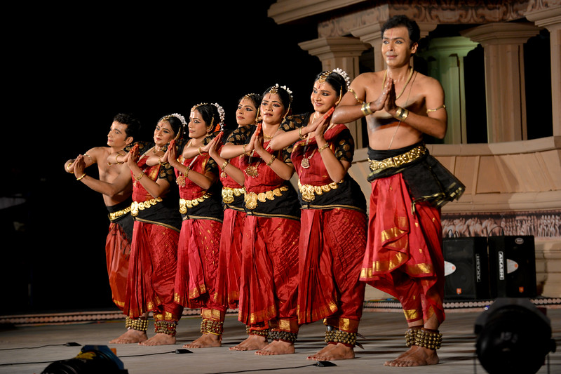"Vaibhav Arekar & Troupe, Bharatnatyam Group's dance performance at the Khajuraho Festival of Dances February, 2014.  Khajuraho Festival of Dances is celebrated at a time when the hardness of winter begins to fade and the king of all seasons, spring, takes over. The most colorful and brilliant classical dance forms of India with their roots in the ling and rich cultural traditions across the country, offer a feast for the eyes during a weeklong extravaganza.  Khajuraho is located in the Indian state of Madhya Pradesh and roughly 620 kilometers (385 miles) southeast of New Delhi, the temples of Khajuraho are famous for their so-called ""erotic sculptures"". Khajuraho was the cultural capital of the Chandela Rajputs, a Hindu dynasty that ruled from the 10th to 12th centuries."
