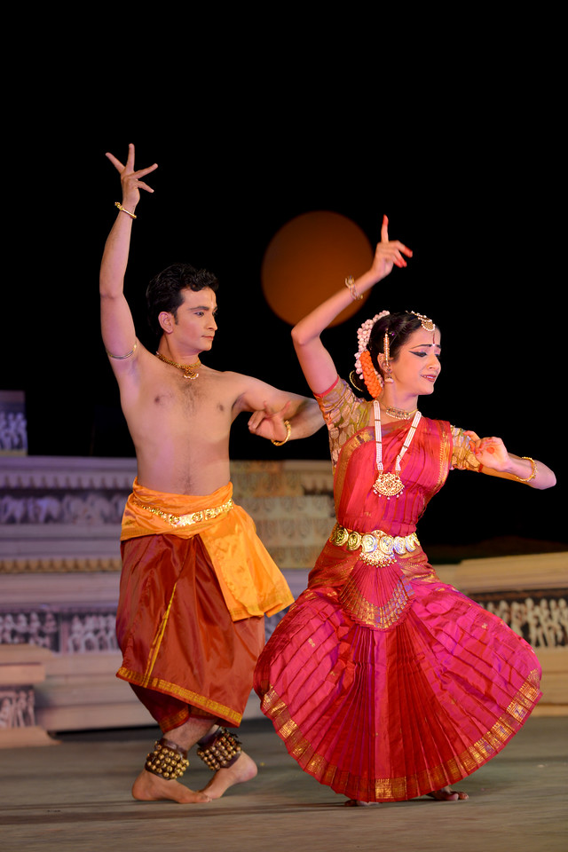"Jignesh Surani and Swarada Datar. Vaibhav Arekar & Troupe, Bharatnatyam Group's dance performance at the Khajuraho Festival of Dances February, 2014.<br /> <br /> Khajuraho Festival of Dances is celebrated at a time when the hardness of winter begins to fade and the king of all seasons, spring, takes over. The most colorful and brilliant classical dance forms of India with their roots in the ling and rich cultural traditions across the country, offer a feast for the eyes during a weeklong extravaganza.<br /> <br /> Khajuraho is located in the Indian state of Madhya Pradesh and roughly 620 kilometers (385 miles) southeast of New Delhi, the temples of Khajuraho are famous for their so-called ""erotic sculptures"". Khajuraho was the cultural capital of the Chandela Rajputs, a Hindu dynasty that ruled from the 10th to 12th centuries."