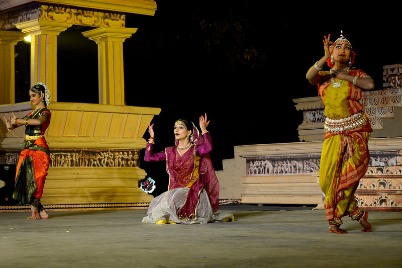 "Dance performance at the Khajuraho Festival of Dances by Vidyagauri Adkar, Mahati Kannan, and Bithika Mistry (Kathak, Bharatnatyam & Odissi).  This festival is celebrated at a time when the hardness of winter begins to fade and the king of all seasons, spring, takes over. The most colorful and brilliant classical dance forms of india with their roots in the ling and rich cultural traditions across the country, offer a feast for the eyes during a weeklong extravaganza.  Khajuraho is located in the Indian state of Madhya Pradesh and roughly 620 kilometers (385 miles) southeast of New Delhi, the temples of Khajuraho are famous for their so-called ""erotic sculptures"". Khajuraho was the cultural capital of the Chandela Rajputs, a Hindu dynasty that ruled from the 10th to 12th centuries."