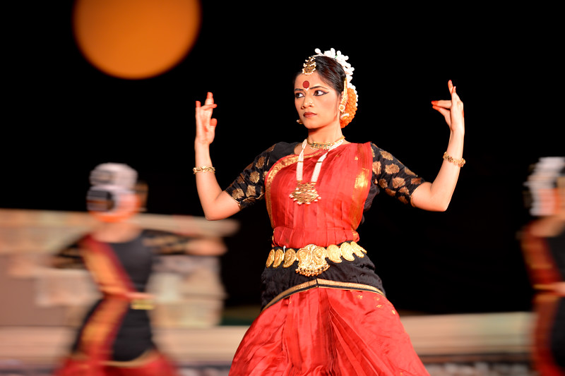 "Vaibhav Arekar & Troupe, Bharatnatyam Group at the Khajuraho Festival of Dances.  This festival is celebrated at a time when the hardness of winter begins to fade and the king of all seasons, spring, takes over. The most colorful and brilliant classical dance forms of india with their roots in the ling and rich cultural traditions across the country, offer a feast for the eyes during a weeklong extravaganza.  Khajuraho is located in the Indian state of Madhya Pradesh and roughly 620 kilometers (385 miles) southeast of New Delhi, the temples of Khajuraho are famous for their so-called ""erotic sculptures"". Khajuraho was the cultural capital of the Chandela Rajputs, a Hindu dynasty that ruled from the 10th to 12th centuries."