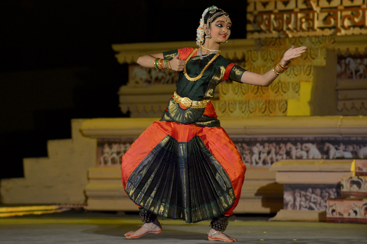 """Mahati Kannan's Bharatnatyam dance performance at the Khajuraho Festival of Dances.<br /> <br /> This festival is celebrated at a time when the hardness of winter begins to fade and the king of all seasons, spring, takes over. The most colorful and brilliant classical dance forms of india with their roots in the ling and rich cultural traditions across the country, offer a feast for the eyes during a weeklong extravaganza.<br /> <br /> Khajuraho is located in the Indian state of Madhya Pradesh and roughly 620 kilometers (385 miles) southeast of New Delhi, the temples of Khajuraho are famous for their so-called """"erotic sculptures"""". Khajuraho was the cultural capital of the Chandela Rajputs, a Hindu dynasty that ruled from the 10th to 12th centuries."""