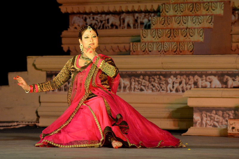 "Kathak & Uzbek dance performance by Samiksha Sharma, Dhirendra Tiwari, and Diyor Aliev at the Khajuraho Festival of Dances February, 2014.  Khajuraho Festival of Dances is celebrated at a time when the hardness of winter begins to fade and the king of all seasons, spring, takes over. The most colorful and brilliant classical dance forms of India with their roots in the ling and rich cultural traditions across the country, offer a feast for the eyes during a weeklong extravaganza.  Khajuraho is located in the Indian state of Madhya Pradesh and roughly 620 kilometers (385 miles) southeast of New Delhi, the temples of Khajuraho are famous for their so-called ""erotic sculptures"". Khajuraho was the cultural capital of the Chandela Rajputs, a Hindu dynasty that ruled from the 10th to 12th centuries."