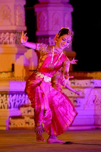 """Swarada Datar. Vaibhav Arekar & Troupe, Bharatnatyam Group's dance performance at the Khajuraho Festival of Dances February, 2014.  Khajuraho Festival of Dances is celebrated at a time when the hardness of winter begins to fade and the king of all seasons, spring, takes over. The most colorful and brilliant classical dance forms of India with their roots in the ling and rich cultural traditions across the country, offer a feast for the eyes during a weeklong extravaganza.  Khajuraho is located in the Indian state of Madhya Pradesh and roughly 620 kilometers (385 miles) southeast of New Delhi, the temples of Khajuraho are famous for their so-called """"erotic sculptures"""". Khajuraho was the cultural capital of the Chandela Rajputs, a Hindu dynasty that ruled from the 10th to 12th centuries."""