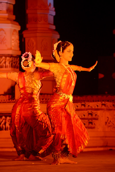 """Vaibhav Arekar & Troupe, Bharatnatyam Group's dance performance at the Khajuraho Festival of Dances February, 2014.  Khajuraho Festival of Dances is celebrated at a time when the hardness of winter begins to fade and the king of all seasons, spring, takes over. The most colorful and brilliant classical dance forms of India with their roots in the ling and rich cultural traditions across the country, offer a feast for the eyes during a weeklong extravaganza.  Khajuraho is located in the Indian state of Madhya Pradesh and roughly 620 kilometers (385 miles) southeast of New Delhi, the temples of Khajuraho are famous for their so-called """"erotic sculptures"""". Khajuraho was the cultural capital of the Chandela Rajputs, a Hindu dynasty that ruled from the 10th to 12th centuries."""
