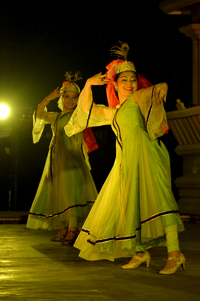 """Zamiram Emirova and Anna Yelissizova.<br /> Kathak & Uzbek dance performance by Samiksha Sharma, Dhirendra Tiwari, and Diyor Aliev at the Khajuraho Festival of Dances February, 2014.<br /> <br /> Khajuraho Festival of Dances is celebrated at a time when the hardness of winter begins to fade and the king of all seasons, spring, takes over. The most colorful and brilliant classical dance forms of India with their roots in the ling and rich cultural traditions across the country, offer a feast for the eyes during a weeklong extravaganza.<br /> <br /> Khajuraho is located in the Indian state of Madhya Pradesh and roughly 620 kilometers (385 miles) southeast of New Delhi, the temples of Khajuraho are famous for their so-called """"erotic sculptures"""". Khajuraho was the cultural capital of the Chandela Rajputs, a Hindu dynasty that ruled from the 10th to 12th centuries."""