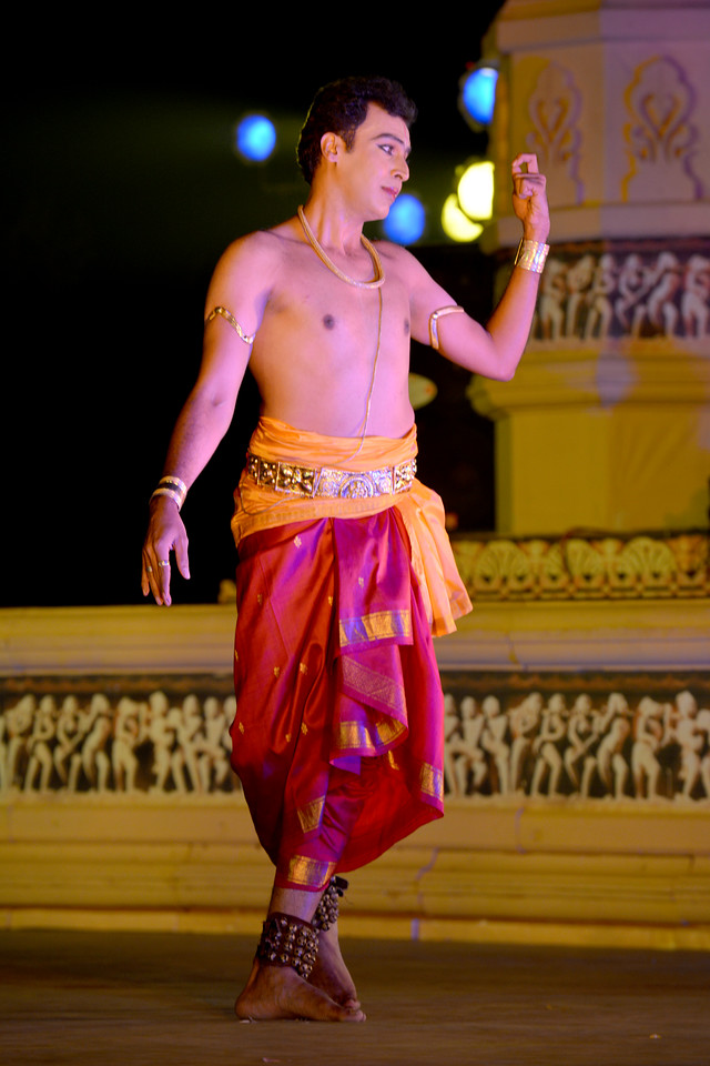 "Vaibhav Arekar. Vaibhav Arekar & Troupe, Bharatnatyam Group's dance performance at the Khajuraho Festival of Dances February, 2014.<br /> <br /> Khajuraho Festival of Dances is celebrated at a time when the hardness of winter begins to fade and the king of all seasons, spring, takes over. The most colorful and brilliant classical dance forms of India with their roots in the ling and rich cultural traditions across the country, offer a feast for the eyes during a weeklong extravaganza.<br /> <br /> Khajuraho is located in the Indian state of Madhya Pradesh and roughly 620 kilometers (385 miles) southeast of New Delhi, the temples of Khajuraho are famous for their so-called ""erotic sculptures"". Khajuraho was the cultural capital of the Chandela Rajputs, a Hindu dynasty that ruled from the 10th to 12th centuries."