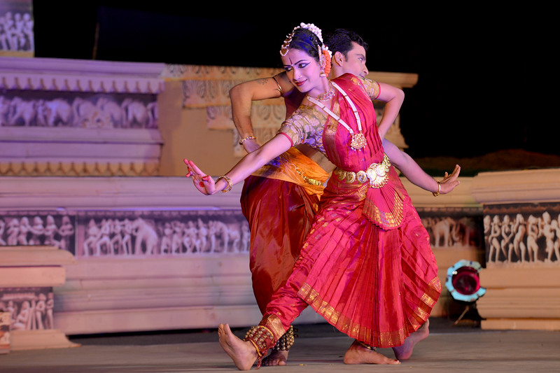 "Swarada Datar. Vaibhav Arekar & Troupe, Bharatnatyam Group's dance performance at the Khajuraho Festival of Dances February, 2014.  Khajuraho Festival of Dances is celebrated at a time when the hardness of winter begins to fade and the king of all seasons, spring, takes over. The most colorful and brilliant classical dance forms of India with their roots in the ling and rich cultural traditions across the country, offer a feast for the eyes during a weeklong extravaganza.  Khajuraho is located in the Indian state of Madhya Pradesh and roughly 620 kilometers (385 miles) southeast of New Delhi, the temples of Khajuraho are famous for their so-called ""erotic sculptures"". Khajuraho was the cultural capital of the Chandela Rajputs, a Hindu dynasty that ruled from the 10th to 12th centuries."