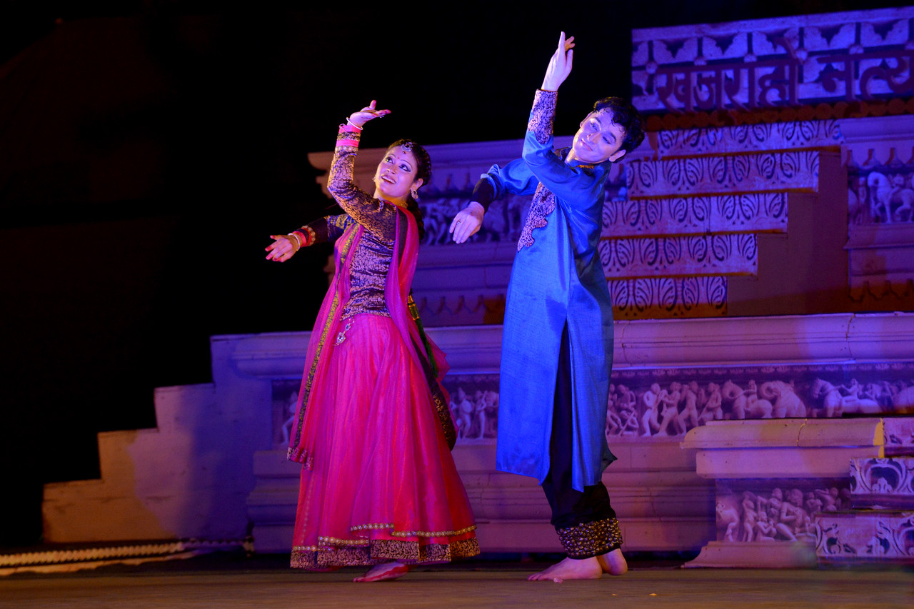 """Dheerendra Tiwari and Samiksha Sharma.<br /> Kathak & Uzbek dance performance by Samiksha Sharma, Dhirendra Tiwari, and Diyor Aliev at the Khajuraho Festival of Dances February, 2014.<br /> <br /> Khajuraho Festival of Dances is celebrated at a time when the hardness of winter begins to fade and the king of all seasons, spring, takes over. The most colorful and brilliant classical dance forms of India with their roots in the ling and rich cultural traditions across the country, offer a feast for the eyes during a weeklong extravaganza.<br /> <br /> Khajuraho is located in the Indian state of Madhya Pradesh and roughly 620 kilometers (385 miles) southeast of New Delhi, the temples of Khajuraho are famous for their so-called """"erotic sculptures"""". Khajuraho was the cultural capital of the Chandela Rajputs, a Hindu dynasty that ruled from the 10th to 12th centuries."""