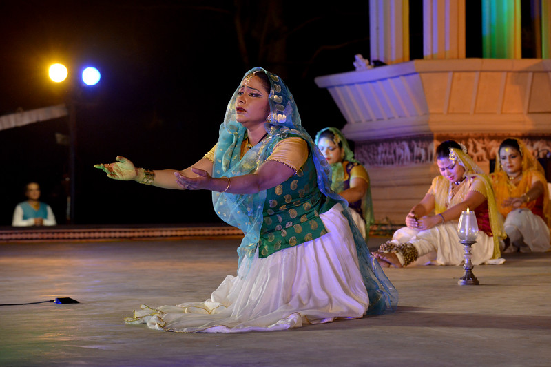"Luna Poddar. Ashimbandhu Bhattacharya & Troupe's Kathak dance performance at the Khajuraho Festival of Dances.  This festival is celebrated at a time when the hardness of winter begins to fade and the king of all seasons, spring, takes over. The most colorful and brilliant classical dance forms of india with their roots in the ling and rich cultural traditions across the country, offer a feast for the eyes during a weeklong extravaganza.  Khajuraho is located in the Indian state of Madhya Pradesh and roughly 620 kilometers (385 miles) southeast of New Delhi, the temples of Khajuraho are famous for their so-called ""erotic sculptures"". Khajuraho was the cultural capital of the Chandela Rajputs, a Hindu dynasty that ruled from the 10th to 12th centuries."