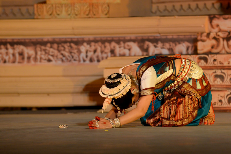 """Alpana Nayak's Odissi dance at the Khajuraho Festival of Dances.<br /> <br /> This festival is celebrated at a time when the hardness of winter begins to fade and the king of all seasons, spring, takes over. The most colorful and brilliant classical dance forms of india with their roots in the ling and rich cultural traditions across the country, offer a feast for the eyes during a weeklong extravaganza.<br /> <br /> Khajuraho is located in the Indian state of Madhya Pradesh and roughly 620 kilometers (385 miles) southeast of New Delhi, the temples of Khajuraho are famous for their so-called """"erotic sculptures"""". Khajuraho was the cultural capital of the Chandela Rajputs, a Hindu dynasty that ruled from the 10th to 12th centuries."""