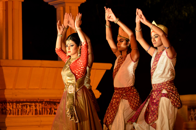 """Marami Medhi, Meghranjani, Dipjyoti, and Dipankar & Troupe's Kathak & Satriya dance performance at the Khajuraho Festival of Dances.  This festival is celebrated at a time when the hardness of winter begins to fade and the king of all seasons, spring, takes over. The most colorful and brilliant classical dance forms of india with their roots in the ling and rich cultural traditions across the country, offer a feast for the eyes during a weeklong extravaganza.  Khajuraho is located in the Indian state of Madhya Pradesh and roughly 620 kilometers (385 miles) southeast of New Delhi, the temples of Khajuraho are famous for their so-called """"erotic sculptures"""". Khajuraho was the cultural capital of the Chandela Rajputs, a Hindu dynasty that ruled from the 10th to 12th centuries."""