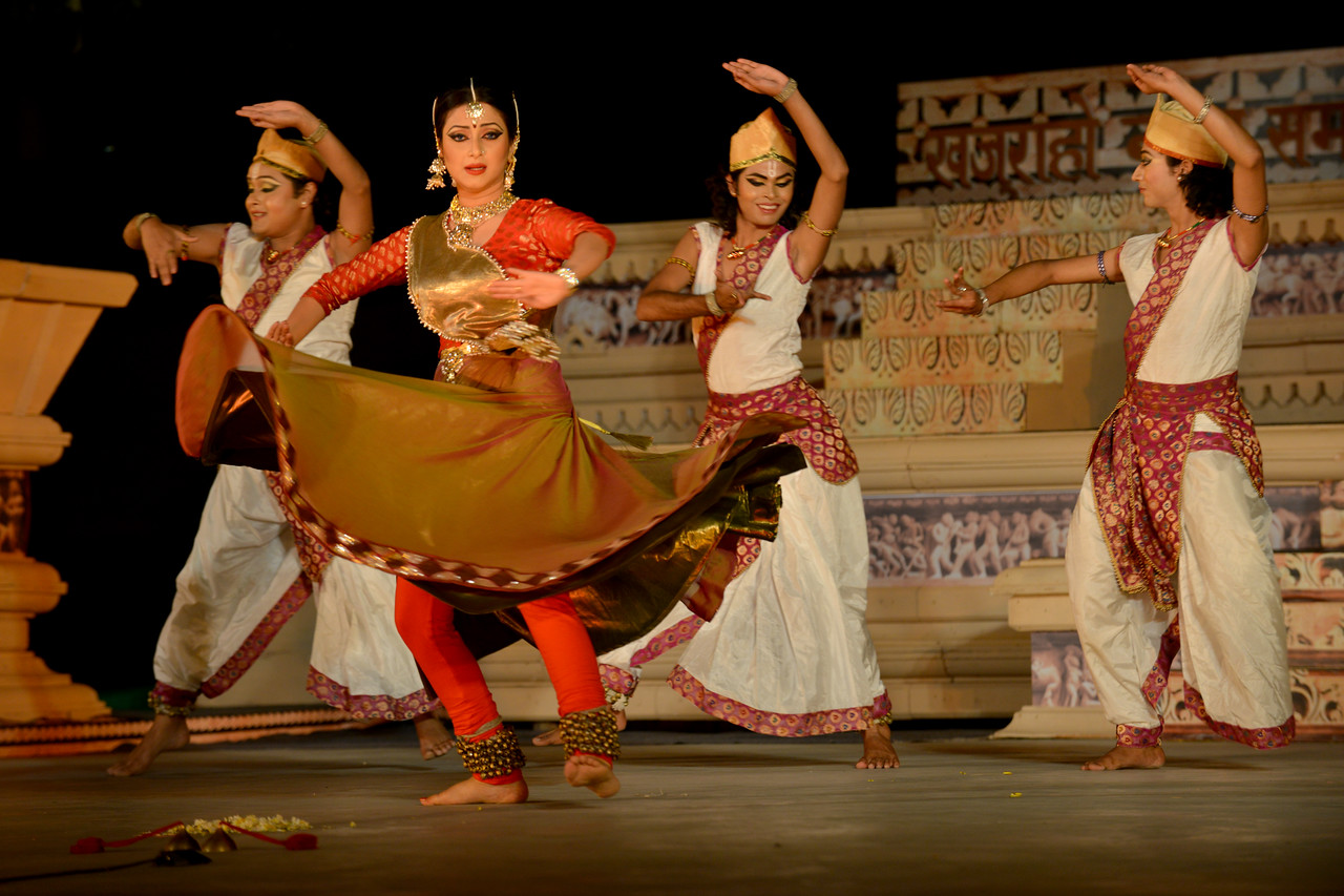 """Marami Medhi, Meghranjani, Dipjyoti, and Dipankar & Troupe's Kathak & Satriya dance performance at the Khajuraho Festival of Dances.<br /> <br /> This festival is celebrated at a time when the hardness of winter begins to fade and the king of all seasons, spring, takes over. The most colorful and brilliant classical dance forms of india with their roots in the ling and rich cultural traditions across the country, offer a feast for the eyes during a weeklong extravaganza.<br /> <br /> Khajuraho is located in the Indian state of Madhya Pradesh and roughly 620 kilometers (385 miles) southeast of New Delhi, the temples of Khajuraho are famous for their so-called """"erotic sculptures"""". Khajuraho was the cultural capital of the Chandela Rajputs, a Hindu dynasty that ruled from the 10th to 12th centuries."""