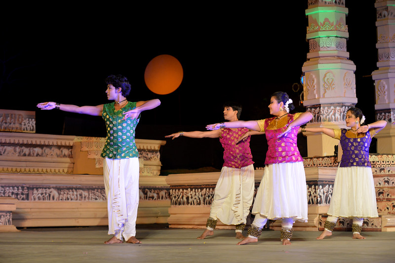 "Ashimbandhu Bhattacharya & Troupe's Kathak dance performance at the Khajuraho Festival of Dances.  This festival is celebrated at a time when the hardness of winter begins to fade and the king of all seasons, spring, takes over. The most colorful and brilliant classical dance forms of india with their roots in the ling and rich cultural traditions across the country, offer a feast for the eyes during a weeklong extravaganza.  Khajuraho is located in the Indian state of Madhya Pradesh and roughly 620 kilometers (385 miles) southeast of New Delhi, the temples of Khajuraho are famous for their so-called ""erotic sculptures"". Khajuraho was the cultural capital of the Chandela Rajputs, a Hindu dynasty that ruled from the 10th to 12th centuries."
