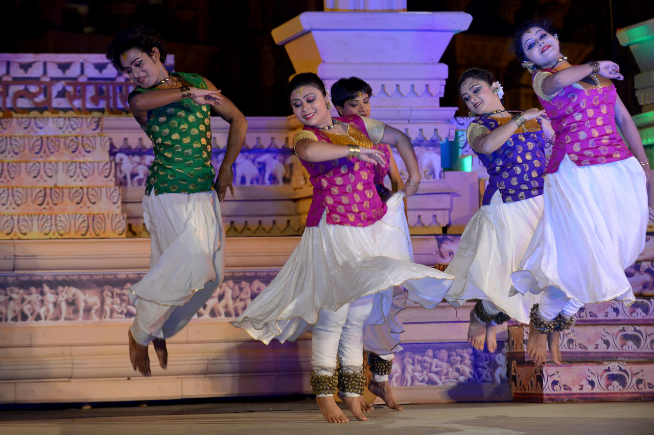 "Ashimbandhu Bhattacharya & Troupe's Kathak dance performance at the Khajuraho Festival of Dances.<br /> <br /> This festival is celebrated at a time when the hardness of winter begins to fade and the king of all seasons, spring, takes over. The most colorful and brilliant classical dance forms of india with their roots in the ling and rich cultural traditions across the country, offer a feast for the eyes during a weeklong extravaganza.<br /> <br /> Khajuraho is located in the Indian state of Madhya Pradesh and roughly 620 kilometers (385 miles) southeast of New Delhi, the temples of Khajuraho are famous for their so-called ""erotic sculptures"". Khajuraho was the cultural capital of the Chandela Rajputs, a Hindu dynasty that ruled from the 10th to 12th centuries."
