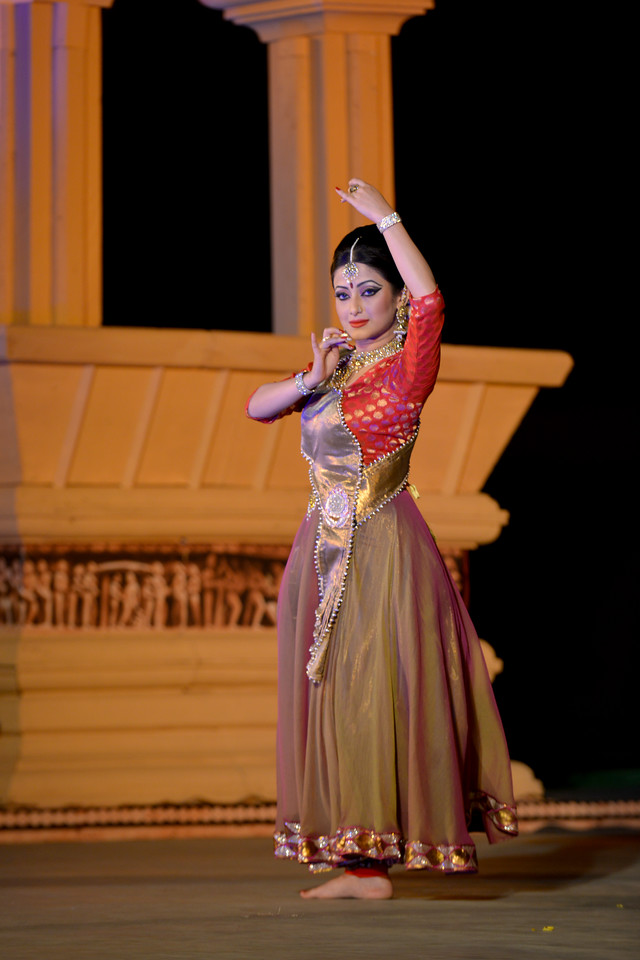 """Meghranjani Medhi is a young and promising artist of Kathak dance. <br /> <br /> Marami Medhi, Meghranjani, Dipjyoti, and Dipankar & Troupe's Kathak & Satriya dance performance at the Khajuraho Festival of Dances.<br /> <br /> This festival is celebrated at a time when the hardness of winter begins to fade and the king of all seasons, spring, takes over. The most colorful and brilliant classical dance forms of india with their roots in the ling and rich cultural traditions across the country, offer a feast for the eyes during a weeklong extravaganza.<br /> <br /> Khajuraho is located in the Indian state of Madhya Pradesh and roughly 620 kilometers (385 miles) southeast of New Delhi, the temples of Khajuraho are famous for their so-called """"erotic sculptures"""". Khajuraho was the cultural capital of the Chandela Rajputs, a Hindu dynasty that ruled from the 10th to 12th centuries."""