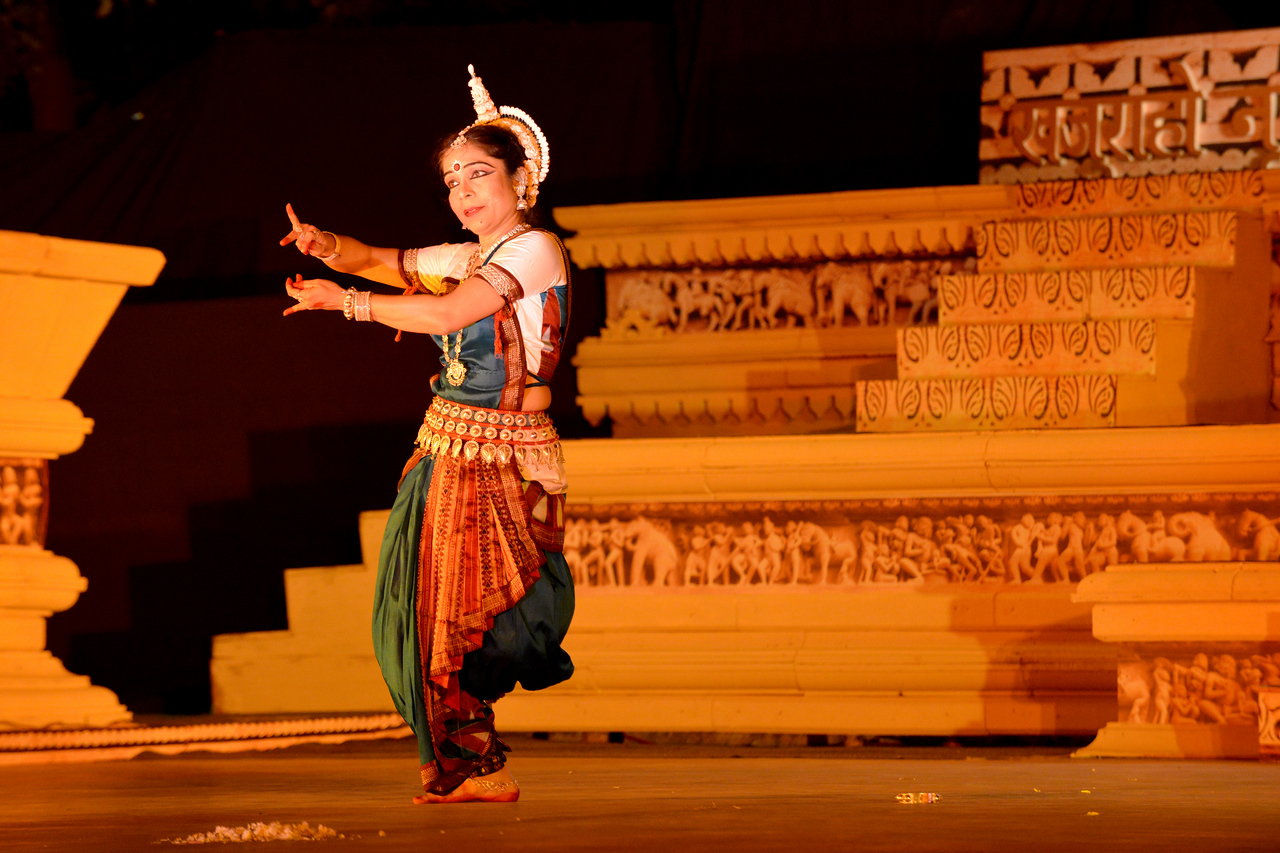 "Alpana Nayak's Odissi dance at the Khajuraho Festival of Dances.<br /> <br /> This festival is celebrated at a time when the hardness of winter begins to fade and the king of all seasons, spring, takes over. The most colorful and brilliant classical dance forms of india with their roots in the ling and rich cultural traditions across the country, offer a feast for the eyes during a weeklong extravaganza.<br /> <br /> Khajuraho is located in the Indian state of Madhya Pradesh and roughly 620 kilometers (385 miles) southeast of New Delhi, the temples of Khajuraho are famous for their so-called ""erotic sculptures"". Khajuraho was the cultural capital of the Chandela Rajputs, a Hindu dynasty that ruled from the 10th to 12th centuries."