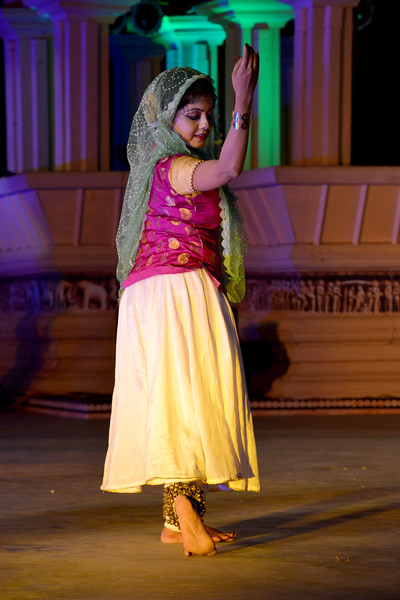 """Ashimbandhu Bhattacharya & Troupe's Kathak dance performance at the Khajuraho Festival of Dances.  This festival is celebrated at a time when the hardness of winter begins to fade and the king of all seasons, spring, takes over. The most colorful and brilliant classical dance forms of india with their roots in the ling and rich cultural traditions across the country, offer a feast for the eyes during a weeklong extravaganza.  Khajuraho is located in the Indian state of Madhya Pradesh and roughly 620 kilometers (385 miles) southeast of New Delhi, the temples of Khajuraho are famous for their so-called """"erotic sculptures"""". Khajuraho was the cultural capital of the Chandela Rajputs, a Hindu dynasty that ruled from the 10th to 12th centuries."""