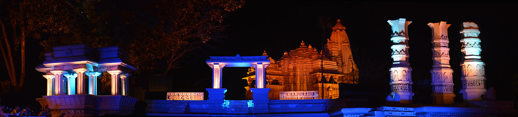 """Panoramic image of Khajuraho Festival of Dances. Khajuraho Festival of Dances is celebrated at a time when the hardness of winter begins to fade and the king of all seasons, spring, takes over. The most colorful and brilliant classical dance forms of india with their roots in the ling and rich cultural traditions across the country, offer a feast for the eyes during a weeklong extravaganza.  Khajuraho is located in the Indian state of Madhya Pradesh and roughly 620 kilometers (385 miles) southeast of New Delhi, the temples of Khajuraho are famous for their so-called """"erotic sculptures"""". Khajuraho was the cultural capital of the Chandela Rajputs, a Hindu dynasty that ruled from the 10th to 12th centuries."""