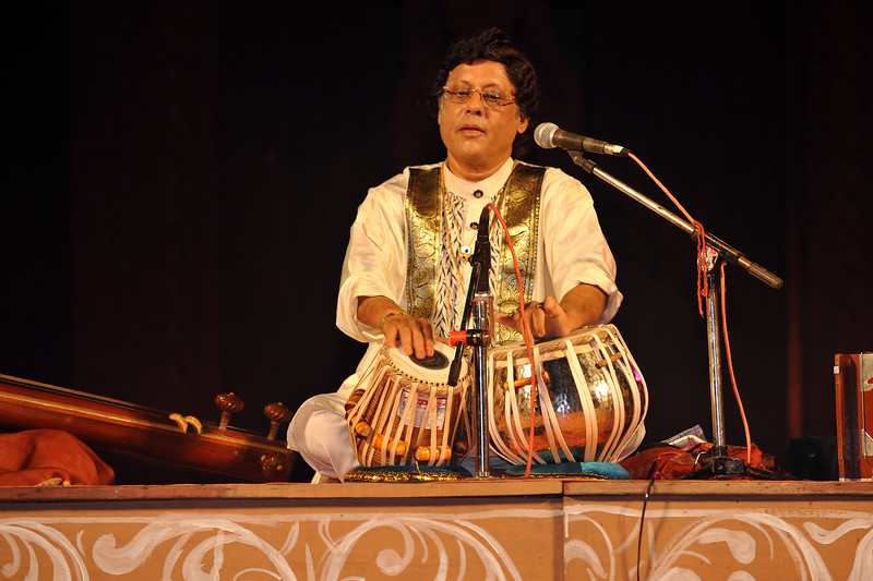 "Pt. Anindo Chatterjee on tabla at the Konark Dance Festival<br /> Pundit Anindo Chatterjee has become the prodigy of Farrukhabad Gharana besides carrying the legacy of the Lucknow Gharana.<br /> <br /> The Konark Dance & Music Festival held from February, 19th to 23rd, 2010 was organized by Konark Natya Mandap.<br /> <br /> The objectives of the Konark Natya Mandap are to preserve, promote, and project the rich cultural heritage of Orissa and to infuse cultural awareness in the minds of all. Started with painstaking efforts of Guru Gangadhar Pradhan, an internationally renowned Odissi dance teacher. 2010 was the silver jubilee year of the festival. For more details see  <a href=""http://www.konarknatyamandap.org/"">http://www.konarknatyamandap.org/</a> <br /> <br /> <br /> The festival takes place in an open-air auditorium and enlivens the spirit of the sculptures of Konark temple which is just a short distance away. The festival brings in the spirit of merry to all the onlookers. The music reverberates and combined with the sounds of the ankle bells of the dancers enthralls the audiences. The elegant steps and expressions of the dancers makes the event so captivating that no one can ever forget it."