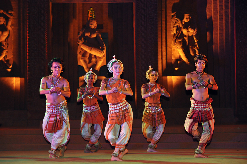 "Ramli Ibrahim's Odissi Dance Group, Sutra Dance Theatre from Kuala Lumpur, Malaysia.<br /> The Konark Dance & Music Festival held from February, 19th to 23rd, 2010 was organized by Konark Natya Mandap.<br /> <br /> The objectives of the Konark Natya Mandap are to preserve, promote, and project the rich cultural heritage of Orissa and to infuse cultural awareness in the minds of all. Started with painstaking efforts of Guru Gangadhar Pradhan, an internationally renowned Odissi dance teacher. 2010 was the silver jubilee year of the festival. For more details see  <a href=""http://www.konarknatyamandap.org/"">http://www.konarknatyamandap.org/</a> <br /> <br /> <br /> The festival takes place in an open-air auditorium and enlivens the spirit of the sculptures of Konark temple which is just a short distance away. The festival brings in the spirit of merry to all the onlookers. The music reverberates and combined with the sounds of the ankle bells of the dancers enthralls the audiences. The elegant steps and expressions of the dancers makes the event so captivating that no one can ever forget it."