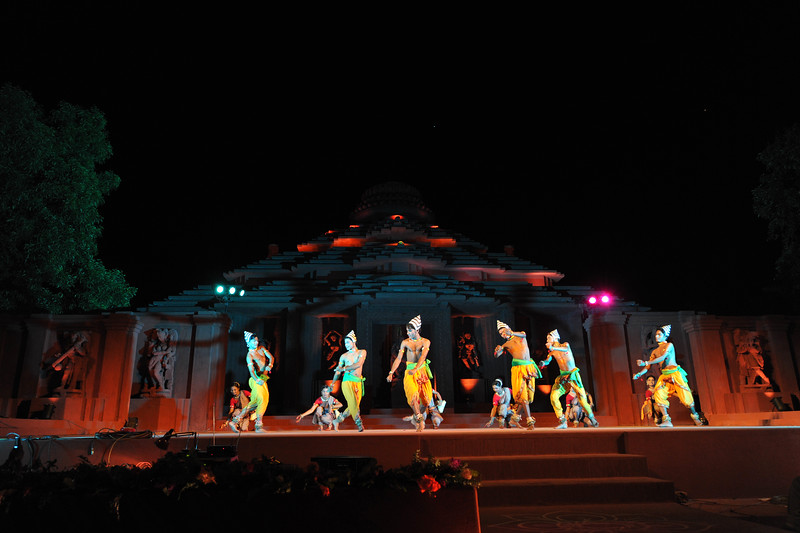 """Chhow Dance by Guru Gour Mohan Mohanta & Troupe, Mayurbhanj.<br /> <br /> The Konark Dance & Music Festival held from February, 19th to 23rd, 2010 was organized by Konark Natya Mandap.<br /> <br /> The objectives of the Konark Natya Mandap are to preserve, promote, and project the rich cultural heritage of Orissa and to infuse cultural awareness in the minds of all. Started with painstaking efforts of Guru Gangadhar Pradhan, an internationally renowned Odissi dance teacher. 2010 was the silver jubilee year of the festival. For more details see  <a href=""""http://www.konarknatyamandap.org/"""">http://www.konarknatyamandap.org/</a> <br /> <br /> <br /> The festival takes place in an open-air auditorium and enlivens the spirit of the sculptures of Konark temple which is just a short distance away. The festival brings in the spirit of merry to all the onlookers. The music reverberates and combined with the sounds of the ankle bells of the dancers enthralls the audiences. The elegant steps and expressions of the dancers makes the event so captivating that no one can ever forget it."""