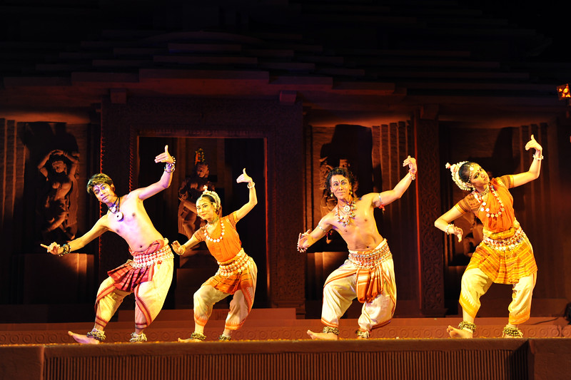 "Odissi Dance Group led by Ramli Ibrahim - Sutra Dance Theatre from Kuala Lumpur, Malaysia.<br /> The Konark Dance & Music Festival held from February, 19th to 23rd, 2010 was organized by Konark Natya Mandap.<br /> <br /> The objectives of the Konark Natya Mandap are to preserve, promote, and project the rich cultural heritage of Orissa and to infuse cultural awareness in the minds of all. Started with painstaking efforts of Guru Gangadhar Pradhan, an internationally renowned Odissi dance teacher. 2010 was the silver jubilee year of the festival. For more details see  <a href=""http://www.konarknatyamandap.org/"">http://www.konarknatyamandap.org/</a> <br /> <br /> <br /> The festival takes place in an open-air auditorium and enlivens the spirit of the sculptures of Konark temple which is just a short distance away. The festival brings in the spirit of merry to all the onlookers. The music reverberates and combined with the sounds of the ankle bells of the dancers enthralls the audiences. The elegant steps and expressions of the dancers makes the event so captivating that no one can ever forget it."