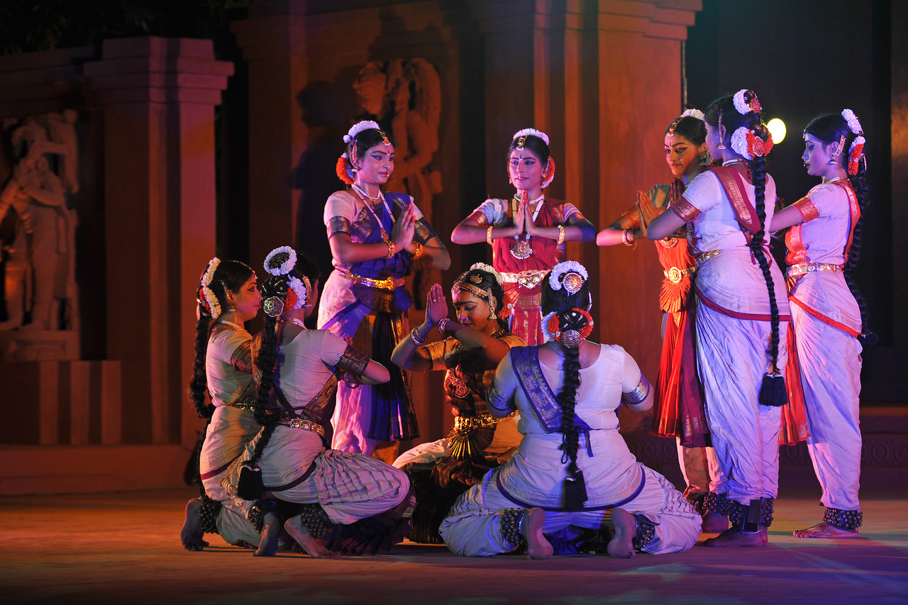 "Bharat Natyam by Divyanjali School of Classical Dance and Music School, Chennai.<br /> The Konark Dance & Music Festival held from February, 19th to 23rd, 2010 was organized by Konark Natya Mandap.<br /> <br /> The objectives of the Konark Natya Mandap are to preserve, promote, and project the rich cultural heritage of Orissa and to infuse cultural awareness in the minds of all. Started with painstaking efforts of Guru Gangadhar Pradhan, an internationally renowned Odissi dance teacher. 2010 was the silver jubilee year of the festival. For more details see  <a href=""http://www.konarknatyamandap.org/"">http://www.konarknatyamandap.org/</a> <br /> <br /> <br /> The festival takes place in an open-air auditorium and enlivens the spirit of the sculptures of Konark temple which is just a short distance away. The festival brings in the spirit of merry to all the onlookers. The music reverberates and combined with the sounds of the ankle bells of the dancers enthralls the audiences. The elegant steps and expressions of the dancers makes the event so captivating that no one can ever forget it."