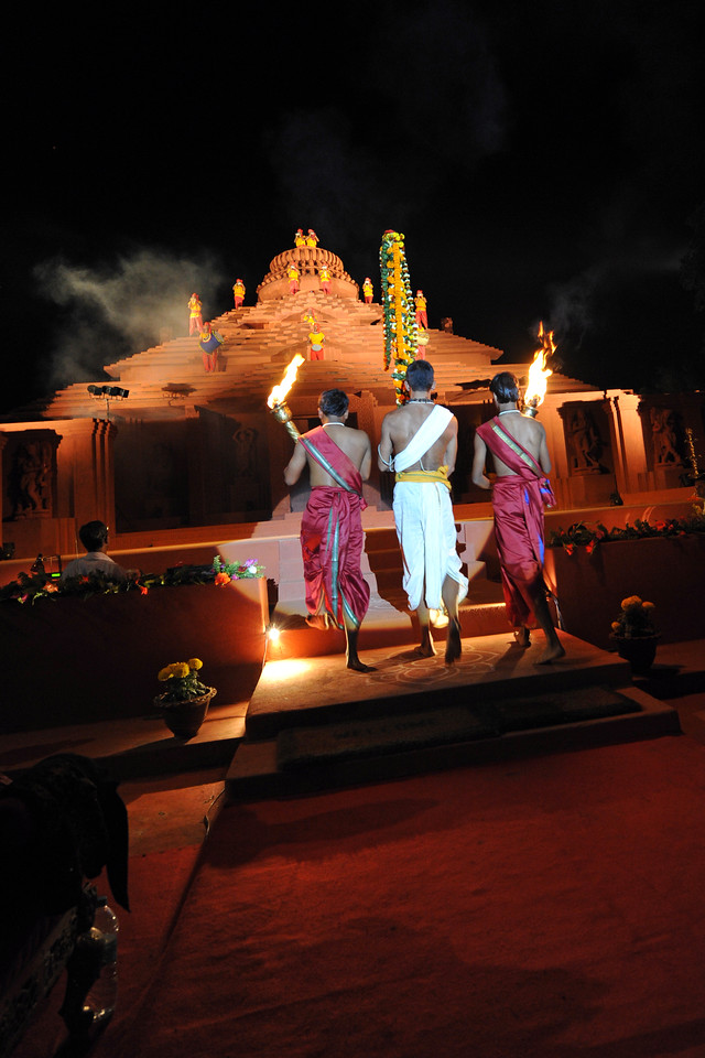 "At the start, the flame arrives to the Natyashala. The Konark Dance & Music Festival held from February, 19th to 23rd, 2010 was organized by Konark Natya Mandap.<br /> <br /> The objectives of the Konark Natya Mandap are to preserve, promote, and project the rich cultural heritage of Orissa and to infuse cultural awareness in the minds of all. Started with painstaking efforts of Guru Gangadhar Pradhan, an internationally renowned Odissi dance teacher. 2010 was the silver jubilee year of the festival. For more details see  <a href=""http://www.konarknatyamandap.org/"">http://www.konarknatyamandap.org/</a> <br /> <br /> <br /> The festival takes place in an open-air auditorium and enlivens the spirit of the sculptures of Konark temple which is just a short distance away. The festival brings in the spirit of merry to all the onlookers. The music reverberates and combined with the sounds of the ankle bells of the dancers enthralls the audiences. The elegant steps and expressions of the dancers makes the event so captivating that no one can ever forget it."