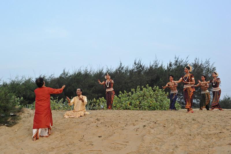 Documentary being filmed on Guru Gangadhar Pradhan and how he started the Konark Natya Mandap. <br /> Guru Gangadhar Pradhan dancing to the Carnatic vocals of Padmabibhushan, Dr. M. Balamuralikrishna at the Konark beach in Orissa.<br /> <br /> This was shot during the Konark Dance & Music Festival held from February, 19th to 23rd, 2010 was organized by Konark Natya Mandap.