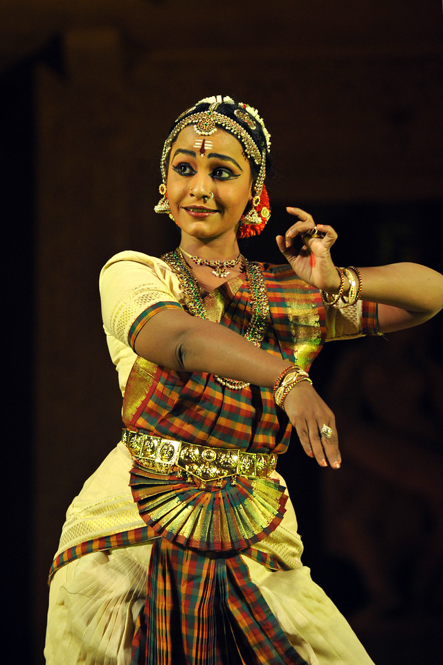 """Bharat Natyam by Divyanjali School of Classical Dance and Music School, Chennai.<br /> The Konark Dance & Music Festival held from February, 19th to 23rd, 2010 was organized by Konark Natya Mandap.<br /> <br /> The objectives of the Konark Natya Mandap are to preserve, promote, and project the rich cultural heritage of Orissa and to infuse cultural awareness in the minds of all. Started with painstaking efforts of Guru Gangadhar Pradhan, an internationally renowned Odissi dance teacher. 2010 was the silver jubilee year of the festival. For more details see  <a href=""""http://www.konarknatyamandap.org/"""">http://www.konarknatyamandap.org/</a> <br /> <br /> <br /> The festival takes place in an open-air auditorium and enlivens the spirit of the sculptures of Konark temple which is just a short distance away. The festival brings in the spirit of merry to all the onlookers. The music reverberates and combined with the sounds of the ankle bells of the dancers enthralls the audiences. The elegant steps and expressions of the dancers makes the event so captivating that no one can ever forget it."""