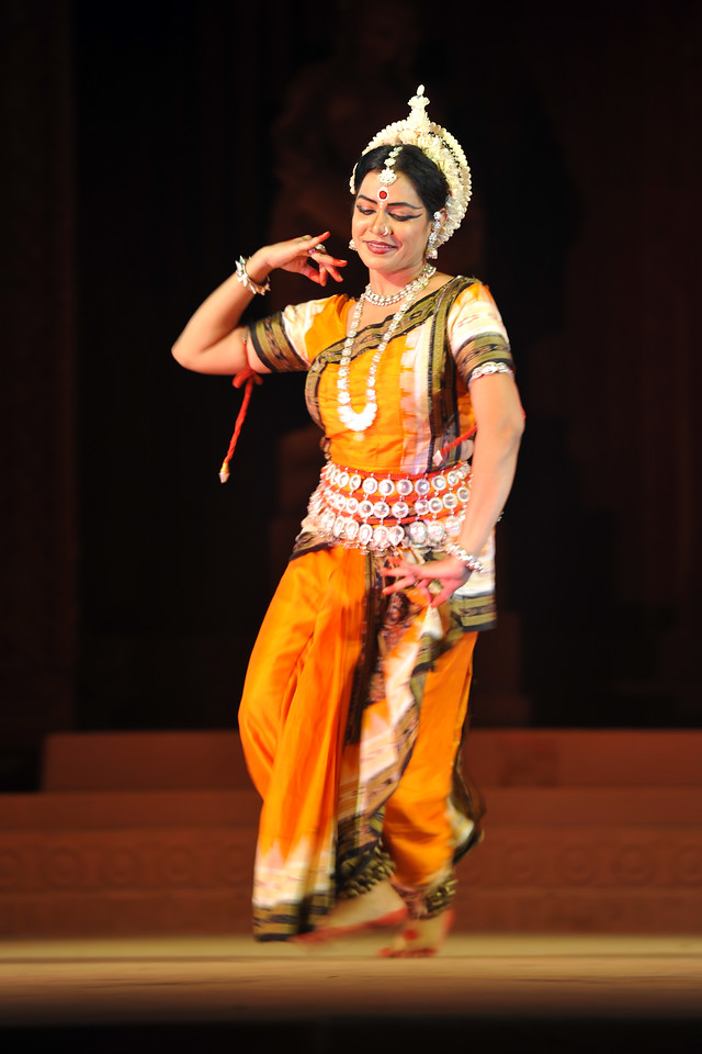 "Odissi Dance by Meera Das, Cuttak.<br /> <br /> The Konark Dance & Music Festival held from February, 19th to 23rd, 2010 was organized by Konark Natya Mandap.<br /> <br /> The objectives of the Konark Natya Mandap are to preserve, promote, and project the rich cultural heritage of Orissa and to infuse cultural awareness in the minds of all. Started with painstaking efforts of Guru Gangadhar Pradhan, an internationally renowned Odissi dance teacher. 2010 was the silver jubilee year of the festival. For more details see  <a href=""http://www.konarknatyamandap.org/"">http://www.konarknatyamandap.org/</a> <br /> <br /> <br /> The festival takes place in an open-air auditorium and enlivens the spirit of the sculptures of Konark temple which is just a short distance away. The festival brings in the spirit of merry to all the onlookers. The music reverberates and combined with the sounds of the ankle bells of the dancers enthralls the audiences. The elegant steps and expressions of the dancers makes the event so captivating that no one can ever forget it."