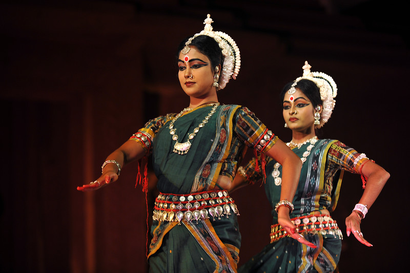 """Odissi Dance by Meera Das and her Gunjan Dance Academy, Cuttak.<br /> <br /> The Konark Dance & Music Festival held from February, 19th to 23rd, 2010 was organized by Konark Natya Mandap.<br /> <br /> The objectives of the Konark Natya Mandap are to preserve, promote, and project the rich cultural heritage of Orissa and to infuse cultural awareness in the minds of all. Started with painstaking efforts of Guru Gangadhar Pradhan, an internationally renowned Odissi dance teacher. 2010 was the silver jubilee year of the festival. For more details see  <a href=""""http://www.konarknatyamandap.org/"""">http://www.konarknatyamandap.org/</a> <br /> <br /> <br /> The festival takes place in an open-air auditorium and enlivens the spirit of the sculptures of Konark temple which is just a short distance away. The festival brings in the spirit of merry to all the onlookers. The music reverberates and combined with the sounds of the ankle bells of the dancers enthralls the audiences. The elegant steps and expressions of the dancers makes the event so captivating that no one can ever forget it."""