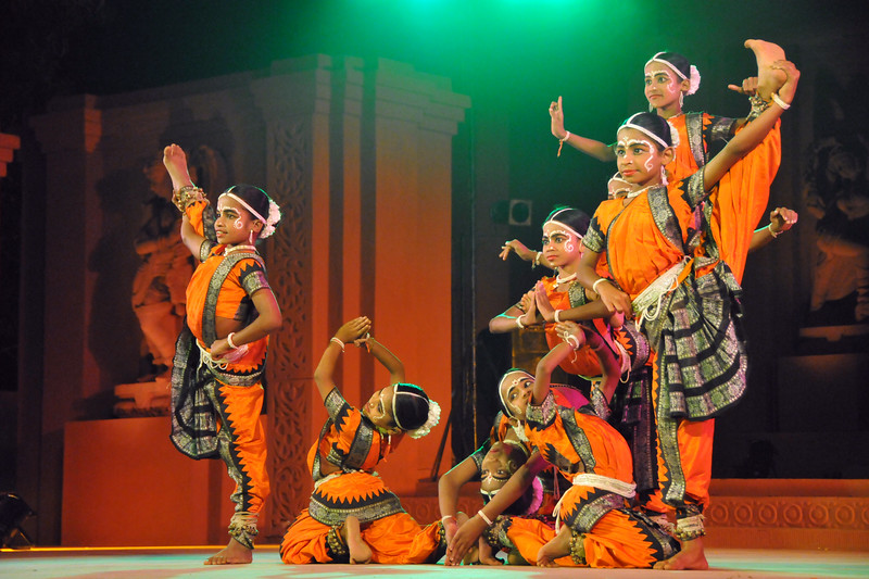 """Young boys between 7 and 11 years old dressed as girls perform Gotipua dance at Konark Natya Mandap, Konark.<br /> <br /> The Konark Dance & Music Festival 2011 held from February, 19th to 23rd, organized by Konark Natya Mandap. The festival takes place in an open-air auditorium and enlivens the spirit of the sculptures of Konark temple which is just a short distance away.<br /> <br /> The objectives of the Konark Natya Mandap are to preserve, promote, and project the rich cultural heritage of Orissa and to infuse cultural awareness in the minds of all. Started with painstaking efforts of internationally renowned Odissi dance teacher Guru Gangadhar Pradhan who unfortunately passed away last year. For more details on the festival see  <a href=""""http://www.konarknatyamandap.org/"""">http://www.konarknatyamandap.org/</a>"""