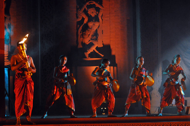 """Start of the event with the bringing of the flame into the Natya Mandap.<br /> <br /> The Konark Dance & Music Festival 2011 held from February, 19th to 23rd, organized by Konark Natya Mandap. The festival takes place in an open-air auditorium and enlivens the spirit of the sculptures of Konark temple which is just a short distance away.<br /> <br /> The objectives of the Konark Natya Mandap are to preserve, promote, and project the rich cultural heritage of Orissa and to infuse cultural awareness in the minds of all. Started with painstaking efforts of internationally renowned Odissi dance teacher Guru Gangadhar Pradhan who unfortunately passed away last year. For more details on the festival see  <a href=""""http://www.konarknatyamandap.org/"""">http://www.konarknatyamandap.org/</a>"""