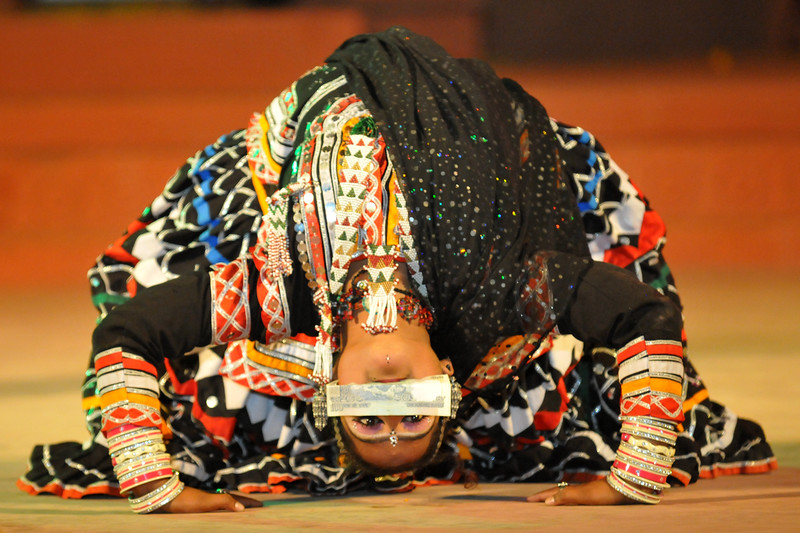 "During Kalbelia, the sensuous folk dance of the snake charmers' community of Rajasthan the lady bends back and lifts a Rs. 100 note.l<br /> Rajsthani Folk Dance - Rajsthani Folk Dance Group, Rajsthan<br /> <br /> The Konark Dance & Music Festival 2011 held from February, 19th to 23rd, organized by Konark Natya Mandap. The festival takes place in an open-air auditorium and enlivens the spirit of the sculptures of Konark temple which is just a short distance away.<br /> <br /> The objectives of the Konark Natya Mandap are to preserve, promote, and project the rich cultural heritage of Orissa and to infuse cultural awareness in the minds of all. Started with painstaking efforts of internationally renowned Odissi dance teacher Guru Gangadhar Pradhan who unfortunately passed away last year. For more details on the festival see  <a href=""http://www.konarknatyamandap.org/"">http://www.konarknatyamandap.org/</a>"