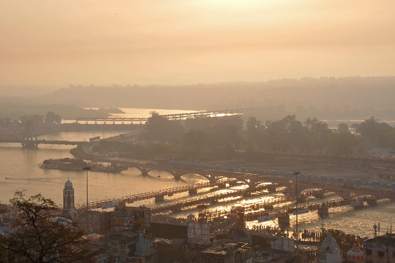 Sunrise over Hari Ki Paudi, Haridwar.<br /> <br /> Kumbh Mela is the biggest religious gatherings on the planet which takes places on the banks of the river Ganga. The number of pilgrims this year is expected to exceed around five million since the first day Jan 14 till the time it concludes on April 28, 2010. The auspicious days of the shahi snan or royal baths usually draw hundreds of thousands of devotees to the Har Ki Paudi and other banks of the river. Uttarakhand. North India. The occasion draws pilgrims from around the world and severly overloads the infrastructure so most of the city is shut down for any vehicles other than security or emergency services so a sea of humanity walks through the city to get to the bathing ghats.