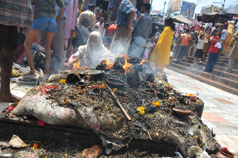 Hawan at Har Ki Pauri, Haridwar. A fire pyre with wood and assorted things at the ghat.<br />  <br /> Kumbh Mela is the biggest religious gatherings on the planet which takes places on the banks of the river Ganga. The number of pilgrims this year is expected to exceed around five million since the first day Jan 14 till the time it concludes on April 28, 2010. The auspicious days of the shahi snan or royal baths usually draw hundreds of thousands of devotees to the Har Ki Paudi and other banks of the river. Uttarakhand. North India. The occasion draws pilgrims from around the world and severly overloads the infrastructure so most of the city is shut down for any vehicles other than security or emergency services so a sea of humanity walks through the city to get to the bathing ghats.