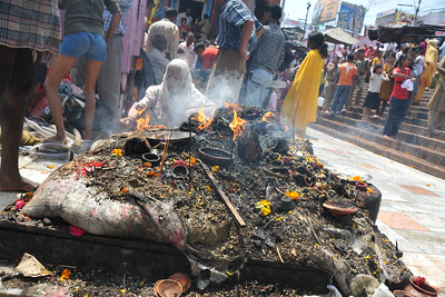 Hawan at Har Ki Pauri, Haridwar. A fire pyre with wood and assorted things at the ghat.   Kumbh Mela is the biggest religious gatherings on the planet which takes places on the banks of the river Ganga. The number of pilgrims this year is expected to exceed around five million since the first day Jan 14 till the time it concludes on April 28, 2010. The auspicious days of the shahi snan or royal baths usually draw hundreds of thousands of devotees to the Har Ki Paudi and other banks of the river. Uttarakhand. North India. The occasion draws pilgrims from around the world and severly overloads the infrastructure so most of the city is shut down for any vehicles other than security or emergency services so a sea of humanity walks through the city to get to the bathing ghats.